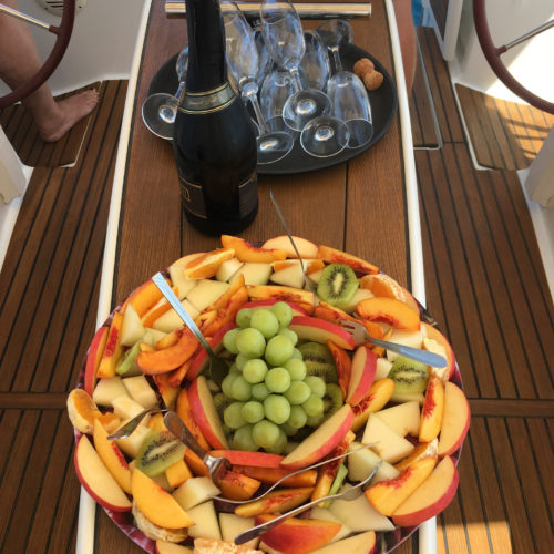 Bottle of Bubbly with fresh fruit salad